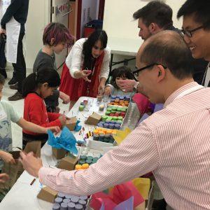 Having fun with kids at We Care craft-making