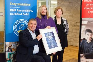 Photo of Ratio client Tamara Vrooman of Vancity and Rick Hansen. receiving gold accessibility certification